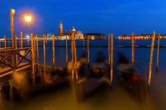 Gondolas at night in Venice, Italy Stock Image