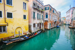 Gondolas parked next to houses in water canal Royalty Free Stock Photos