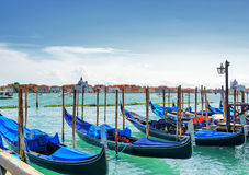 Gondolas parked beside the Riva degli Schiavoni in Venice, Italy Stock Photography