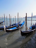 Gondolas parked on a Venetian water canal Stock Photography