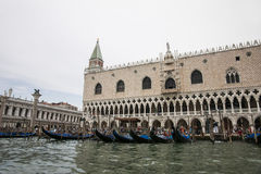 Gondolas parking near Doges palace in summer Venice Stock Images