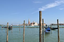 Gondolas with passengers in movement in Venice lagoon Royalty Free Stock Photo