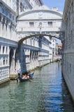 Gondolas passing over Bridge of Sighs - Ponte dei Sospiri. Venic Royalty Free Stock Photos