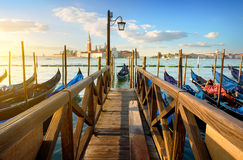 Gondolas and pier Stock Images