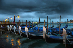 Gondolas in pier near Grand Canal, Venice Royalty Free Stock Images