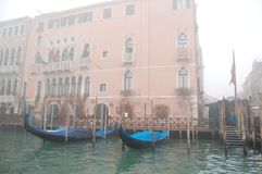 Gondolas at the pier, Venice. Closed from dampness after work. stock photo