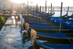 Gondolas at a pier in Venice, Italy Royalty Free Stock Image