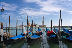Gondolas on quay near San Marco Royalty Free Stock Photo