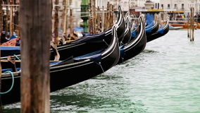 Gondolas rocking on the waves on the main parking near Piazza San Marco in Venecia, Italy stock video footage