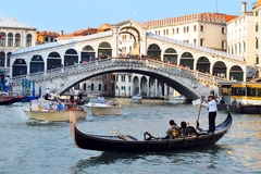 Gondolas sail on the Grand Canal in Venice, Italy under the Rial Royalty Free Stock Images