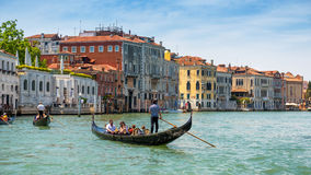 Gondolas are sailing along the Grand Canal in Venice Royalty Free Stock Photos