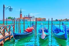 Gondolas and San Giorgio di Maggiore church in Venice stock images