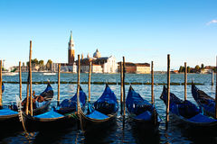 Gondolas and San Giorgio Maggiore. Typical Venice canal with blue gondolas and San Giorgio Maggiore Basilica in the back,seen from St Mark's Square Stock Images