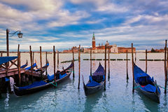 Gondolas and San Giorgio Maggiore church in Venice. Royalty Free Stock Photo