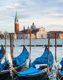 Gondolas and San Giorgio Maggiore church in Venice. Stock Photos