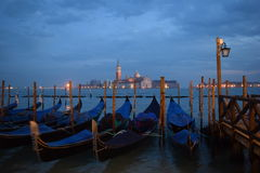 Gondolas and San Giorgio Maggiore in evening Royalty Free Stock Images