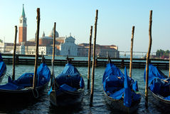 Gondolas at san marco place. Photo of some gondolas at san marco place with the island of san angelo as a background Stock Photos