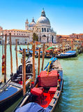 Gondolas with Santa Maria della Salute in Venice. Traditional Gondolas with Basilica di Santa Maria della Salute in the background in Venice, Italy royalty free stock photography