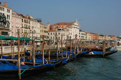 Gondolas on a shore in Venice Stock Photo