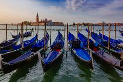 Gondolas by St. Mark`s Square and San Giorgio Maggiore in Venice royalty free stock photography