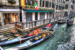 Gondolas by the stairs in Venice Royalty Free Stock Images