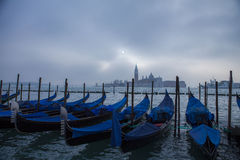 Gondolas sunrise foggy day Venice Italy Stock Image