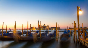 Gondolas at sunrise with San Giorgio di Maggiore church, Venice, Stock Photos