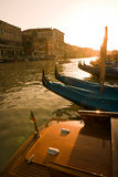 Gondolas at sunset in Venice. Gondola prows in golden hour light on Grand Canal - Venice, Venezia, Italy, Europe Royalty Free Stock Photography