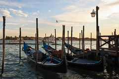 Gondolas at sunset in Venice Royalty Free Stock Photos