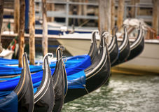 Gondolas tails in Venice Royalty Free Stock Image