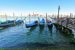 Gondolas at their moorings in the evening in Venice, Italy Stock Photo