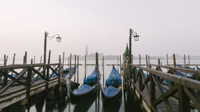 Gondolas at their moorings in Venice, Veneto, Italy, Europe Stock Photo