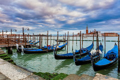Gondolas tied on Grand canal in Venice, Italy. Royalty Free Stock Photo