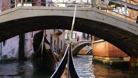 Gondolas took the passengers passing through bridges stock footage