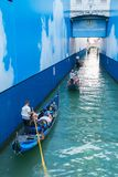 Gondolas with tourists swim under the Bridge of Sighs in Venice Royalty Free Stock Photo