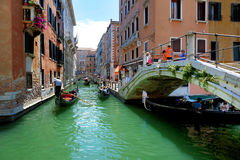The gondolas with tourists is on water channel Stock Images