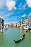 Gondolas transports tourists along the Grand Canal in Venice Royalty Free Stock Photos