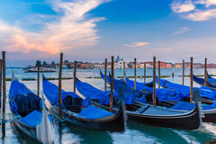 Gondolas at twilight in Venice lagoon, Italia Royalty Free Stock Images