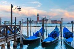 Gondolas at twilight in Venice lagoon, Italia Stock Image