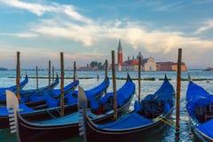 Gondolas at twilight in Venice lagoon, Italia Royalty Free Stock Photos