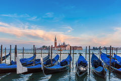 Gondolas at twilight in Venice lagoon, Italia Royalty Free Stock Image