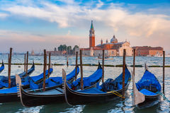 Gondolas at twilight in Venice lagoon, Italia Stock Photo