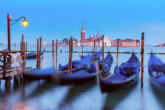 Gondolas at twilight in Venice lagoon, Italia Royalty Free Stock Photography