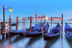 Gondolas at twilight in Venice lagoon, Italia Royalty Free Stock Photography