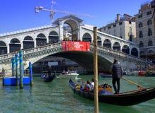 Gondolas under Rialto Bridge,Venice Stock Photo