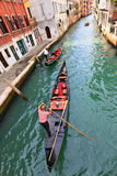 Gondolas on a Venetian canal Stock Photos