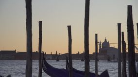 Venice gondolas swaying on the waves and buildings stock video footage