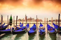 Gondolas in Venezia. Gondolas moored by Saint Mark square with San Giorgio di Maggiore church in the background - Venice, Venezia, Italy, Europe stock photography