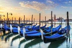 Gondolas in Venezia. Gondolas moored by Saint Mark square with San Giorgio di Maggiore church in the background - Venice, Venezia, Italy, Europe stock photo
