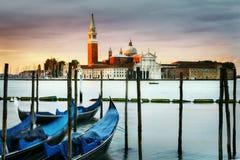 Gondolas in Venezia. Gondolas moored by Saint Mark square with San Giorgio di Maggiore church in the background - Venice, Venezia, Italy, Europe royalty free stock photo